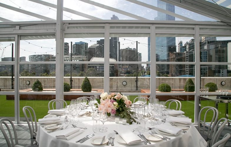 crown melbourne aviary table looking out over melbourne skyline rooftop
