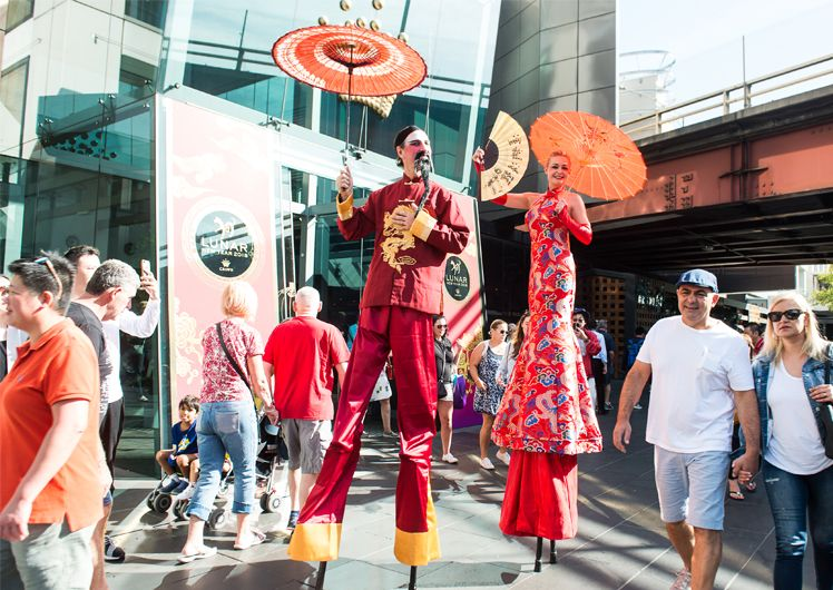 stilt walkers roving entertainment hawkers bazaar