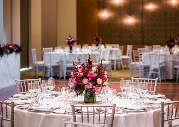 Wedding dining setting with flowers at Crown Melbournes Garden Room