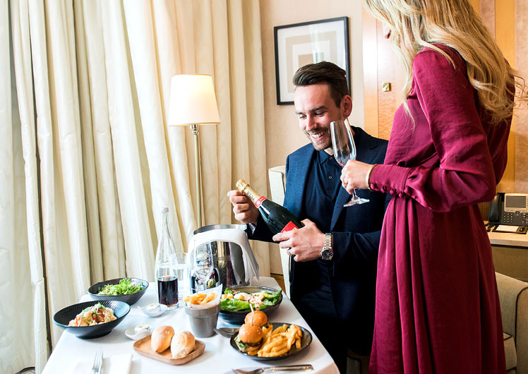 Couple indulge in room service at Crown Towers Melbourne
