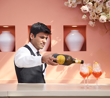 male pouring champagne for crown melbourne events & conferences